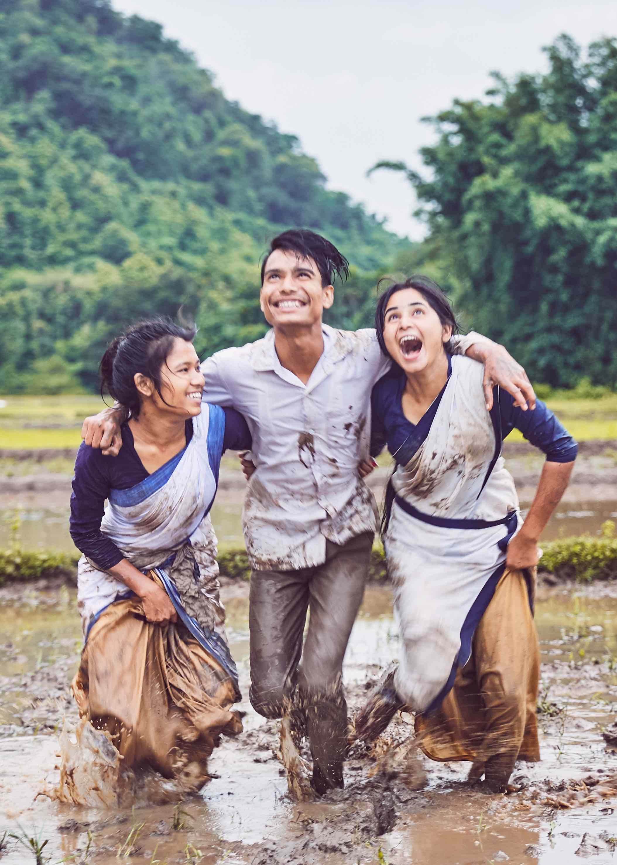 Three lead characters in the rain